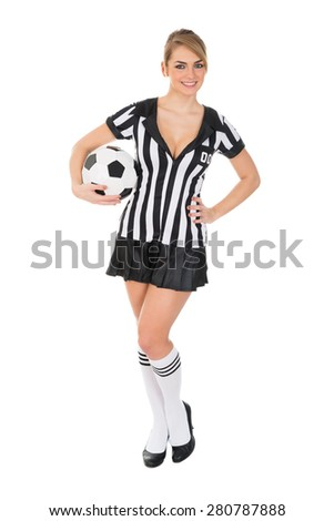 Portrait Of Female Referee Holding Football In Hand Over White Background - stock photo