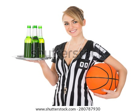 Portrait Of Female Referee With Drinks And Basketball Over White Background - stock photo