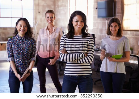 Portrait Of Female Staff Standing In Modern Design Office - stock photo