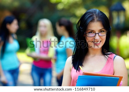 portrait of female student in glasses outdoors