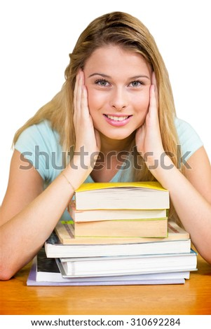 Portrait of female student in library against white background with vignette