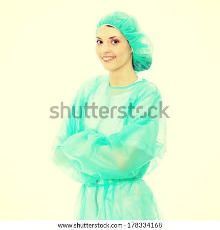 Portrait of female surgeon or nurse wearing protective uniform, isolated on white background - stock photo