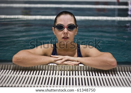 Portrait of female swimming athlete on swimming pool - stock photo