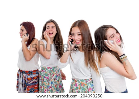 Portrait of female teen group talking on smart phones.Isolated on white background.