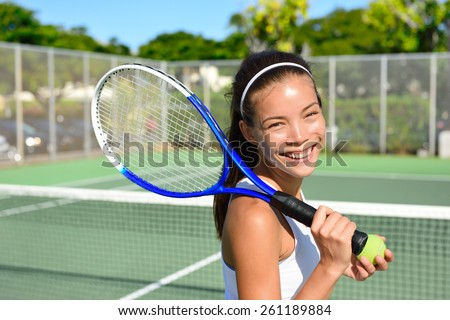 Portrait of female tennis player holding tennis racket after playing at game outside on hard court in summer. Fit woman sport fitness athlete smiling happy living healthy active lifestyle outside.