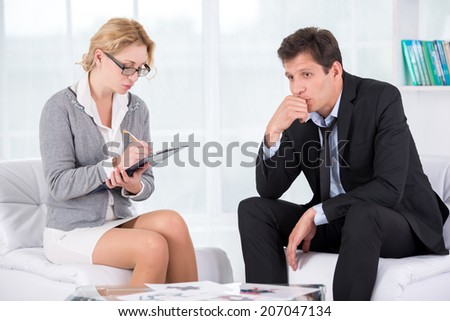 Portrait of female therapist in office with her patient - stock photo