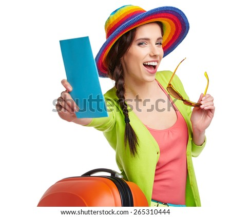 Portrait of female tourist with travel suitcase and blue boarding pass, isolated on white - stock photo