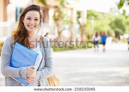 Portrait Of Female University Student Outdoors On Campus - stock photo