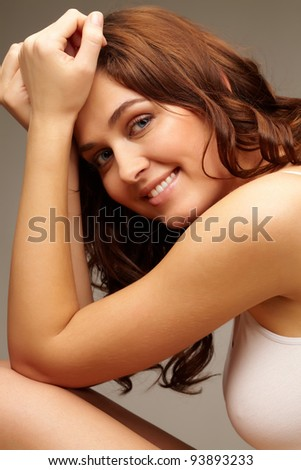 Portrait of feminine woman looking at camera with smile