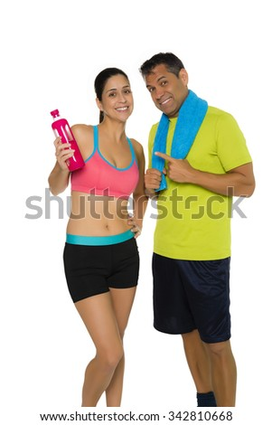 Portrait of fit Hispanic couple in workout attire - stock photo