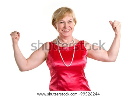 Portrait of fit senior woman flexing her biceps against white background. Laughing woman proud of herself. - stock photo