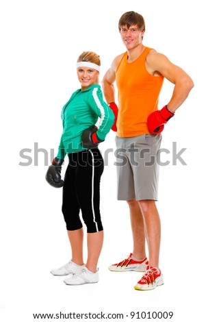 Portrait of fit young woman and man in boxing gloves isolated on white - stock photo