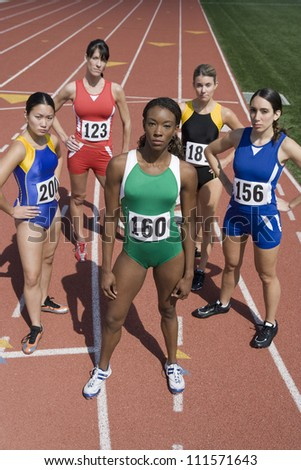 Portrait of five female athlete standing on track and field
