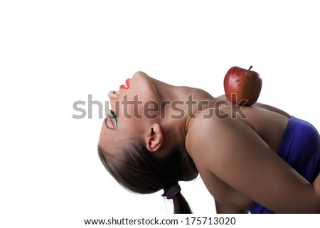 Portrait of flexible young girl posing with apple - stock photo