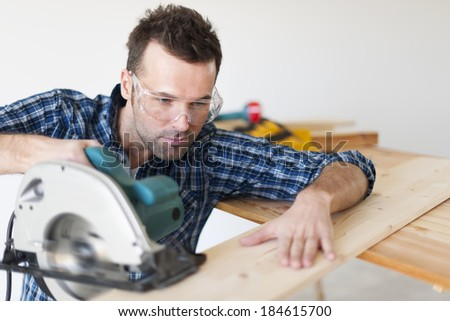 Portrait of focus carpenter at work   - stock photo