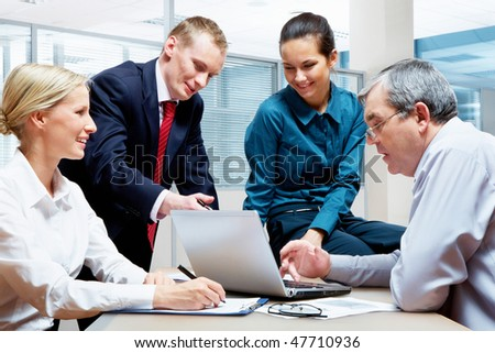Portrait of four businesspeople working together in the office
