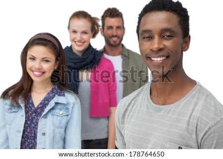 Portrait of four happy young friends standing over white background