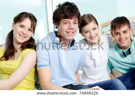 Portrait of four smiling teenagers looking at camera