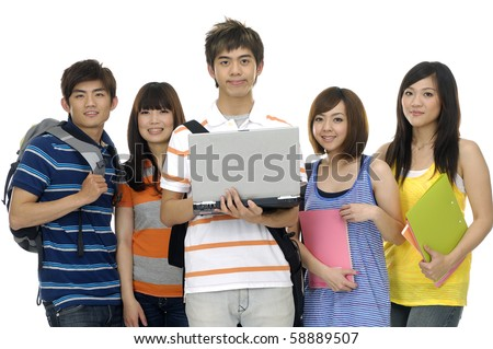 Portrait of four students with notebooks and paper folders posing focus on young man using Laptop - stock photo