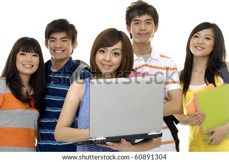 Portrait of four students with notebooks and paper folders posing focus on young woman using Laptop - stock photo