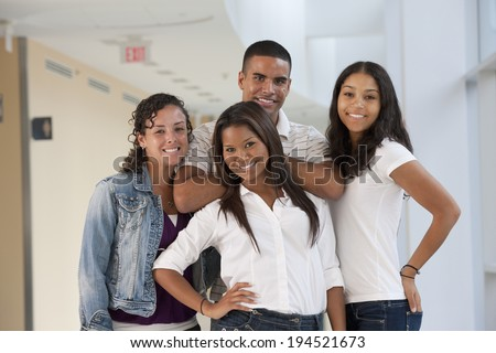 Portrait of four university students smiling