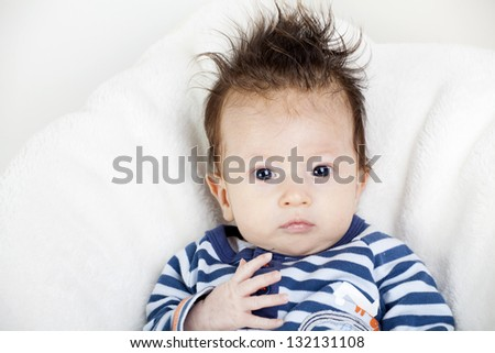 Portrait of four-weeks old baby with funny hair - stock photo