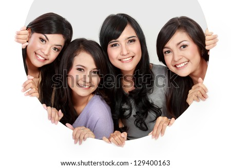 portrait of four  woman in circle hole