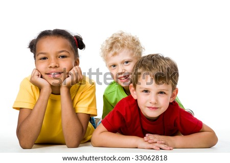 Portrait of free children looking at camera and lying - stock photo