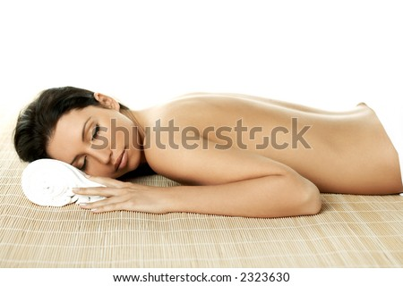Portrait of Fresh and Beautiful brunette woman laying on bamboo mat - stock photo