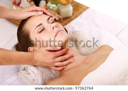 Portrait of fresh and beautiful brunette woman taking head massage - stock photo