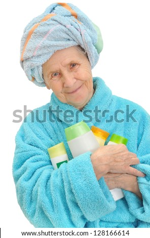 Portrait of fresh and beautiful grey haired woman with towel on her head isolated on white - stock photo