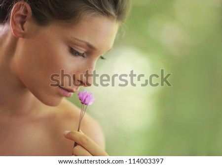 Portrait of Fresh and Beautiful woman with flower. Soft focus