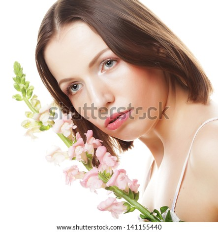 Portrait of Fresh and Beautiful woman with pink flowers isolated on white