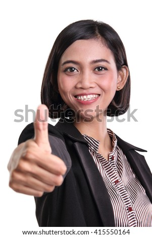 Portrait of friendly Asian business woman congratulating with her thumb up, isolated on white background - stock photo