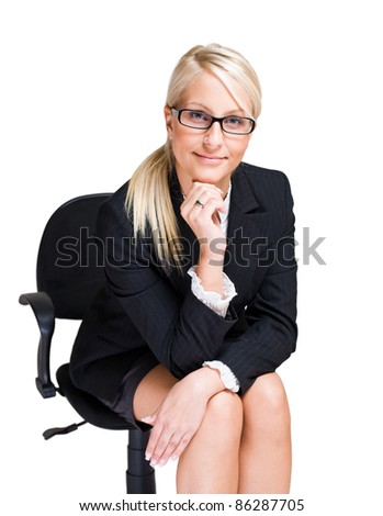 Portrait of friendly attractive blond business woman sitting in office chair isolated on white background. - stock photo