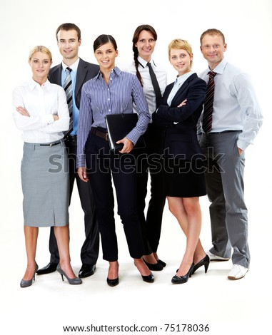 Portrait of friendly business team standing in isolation