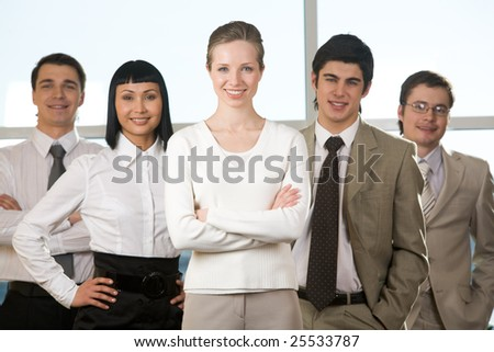 Portrait of friendly company with smart leader in the center