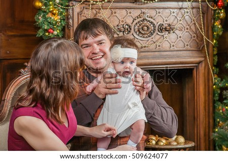 Portrait of friendly happy people near Christmas tree and fireplace
