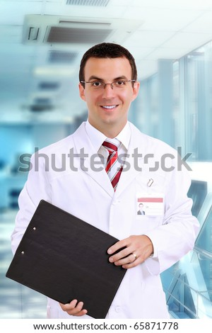 Portrait of friendly medical doctor medical pad. - stock photo