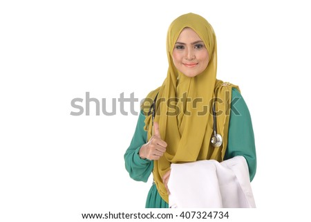 Portrait of friendly, smiling confident muslim female doctor, healthcare professional Showing Best Of Luck Sign isolated on white background. - stock photo
