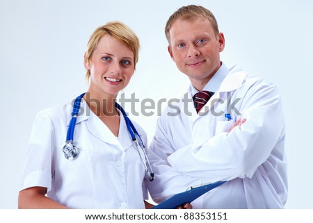Portrait of friendly therapists looking at camera with smiles - stock photo