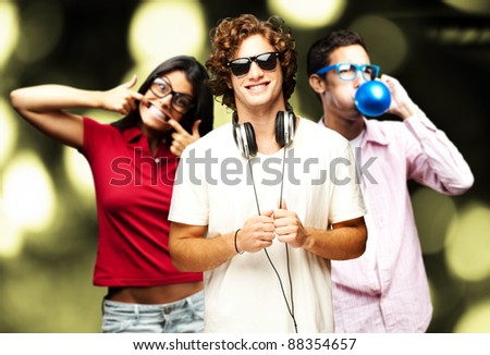 portrait of friends having a party against a abstract background - stock photo