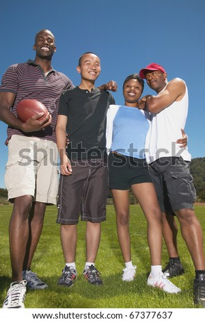 Portrait of friends with football