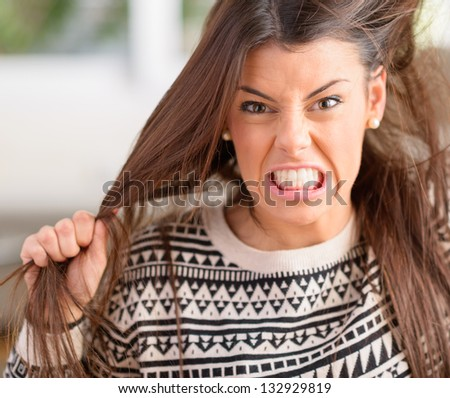 Portrait Of Frustrated And Angry Woman Pulling Her Hair