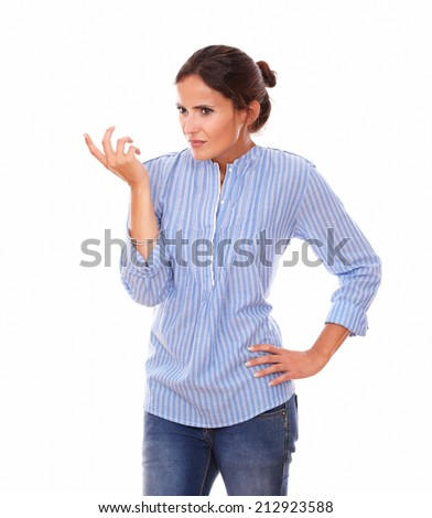 Portrait of frustrated hispanic woman asking a question to herself while looking to her right and standing on isolated studio - stock photo