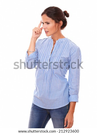 Portrait of frustrated latin woman on blue blouse wondering and looking to her right while standing on isolated white background - copyspace - stock photo