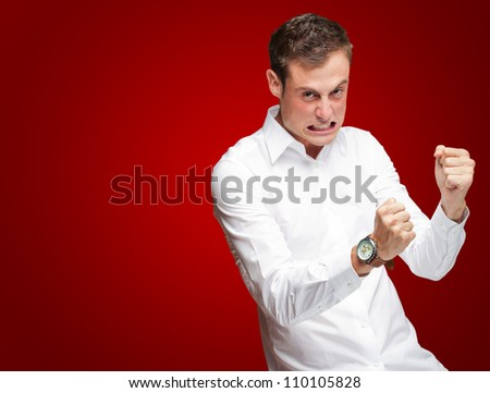 Portrait Of  Frustrated Young Man On Red Background - stock photo