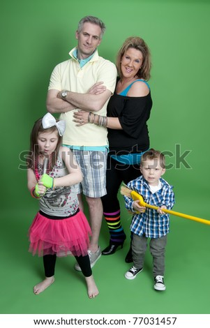 Portrait of fun family wearing colorful 80's costumes