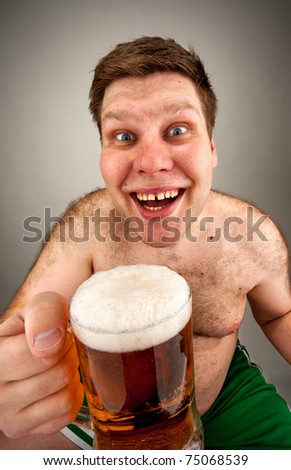 Portrait of funny fat man with glass of beer - stock photo