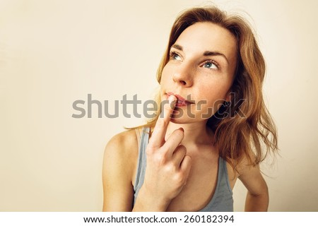 Portrait of Funny girl in doubt about something - wide lens effect. - stock photo